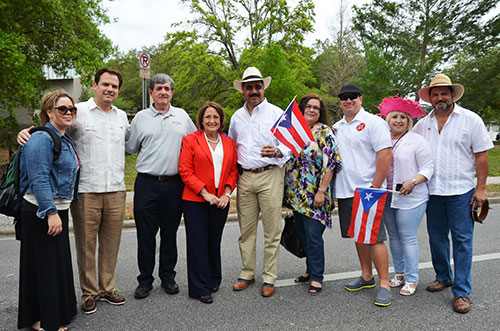 Mayor Teresa Jacobs is joined by Mercedes Fonseca, Orange County Clerk of Courts Eddie Fernández, Orange County Commissioner Pete Clarke, City of Orlando Commissioner Tony Ortiz, Ana Cruz, Luis Urra, Carmen Acevedo and Eduardo Rivera at the Puerto Rican Parade and Festival on Sunday.
