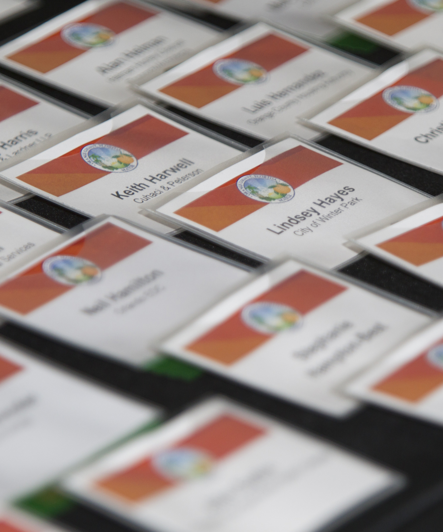 Image of Name Badges at Economic Summit, Links to Economic Summit Page