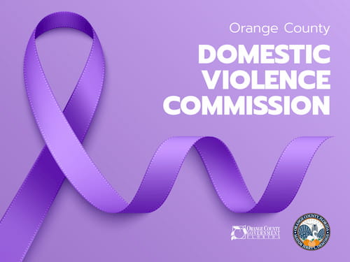 A purple ribbon, including the text 'Orange County Domestic Violence Commission'